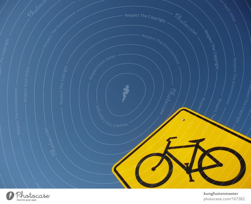 Bicycle path to heaven Colour photo Exterior shot Day Contrast Sunlight Cloudless sky Transport Road traffic Street Road sign Metal Sign Driving Blue Yellow