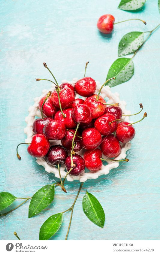Ripe sweet cherry with leaves in white bowl Food Fruit Dessert Nutrition Organic produce Vegetarian diet Bowl Style Design Healthy Healthy Eating Life Summer