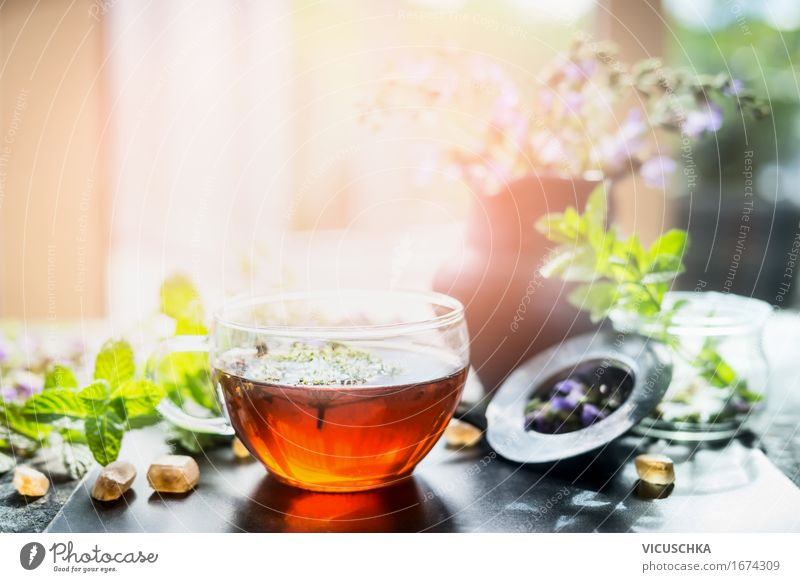 Cup with herbal tea on windowsill Food Herbs and spices Nutrition Organic produce Beverage Hot drink Tea Glass Spoon Lifestyle Style Design Healthy