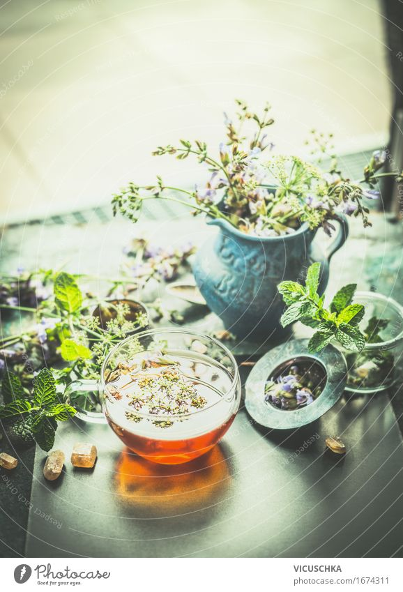 Cup with herbal tea on the terrace or garden table Food Herbs and spices Organic produce Vegetarian diet Diet Beverage Hot drink Tea Bottle Glass Lifestyle