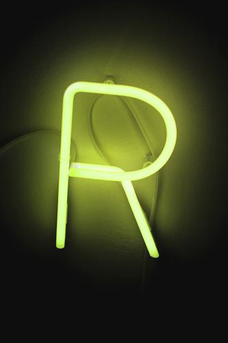 R Sign Characters Dark Yellow Green Neon sign Fluorescent Lights Lighting Lighting element Colour photo Interior shot Deserted Copy Space top Copy Space bottom