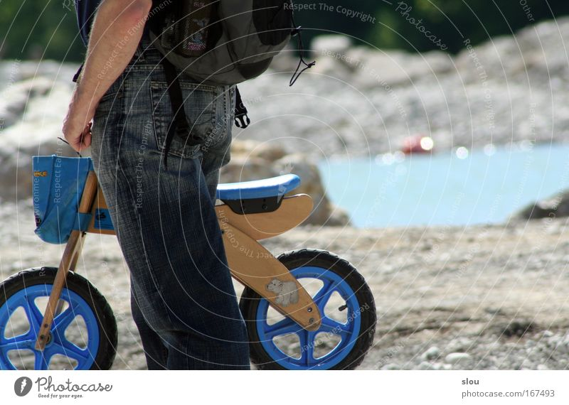 Isar rider Colour photo Exterior shot Day Sunlight Central perspective Human being Masculine Child Infancy Arm Bottom Legs 1 1 - 3 years Toddler Nature