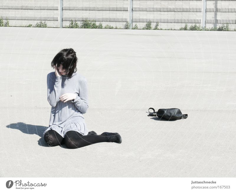 What do we do now? Woman Young woman Sit Crouch Sheepish Shadow Contrast Gray Bright Bag Handbag Mini dress Dress Places Concrete Meditative Think Timidity