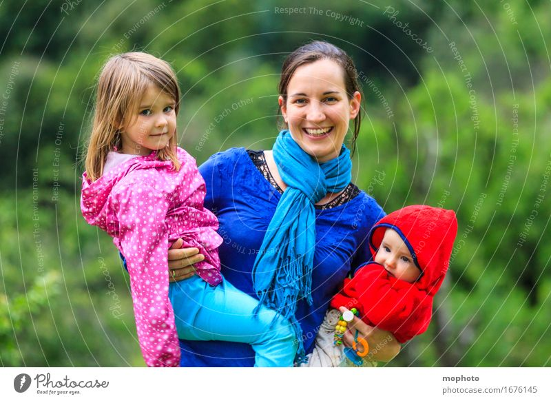 Mother with two small children in her arms Joy Happy Life Parenting Kindergarten Child Profession Kindergarten teacher Human being Feminine Baby Toddler Girl