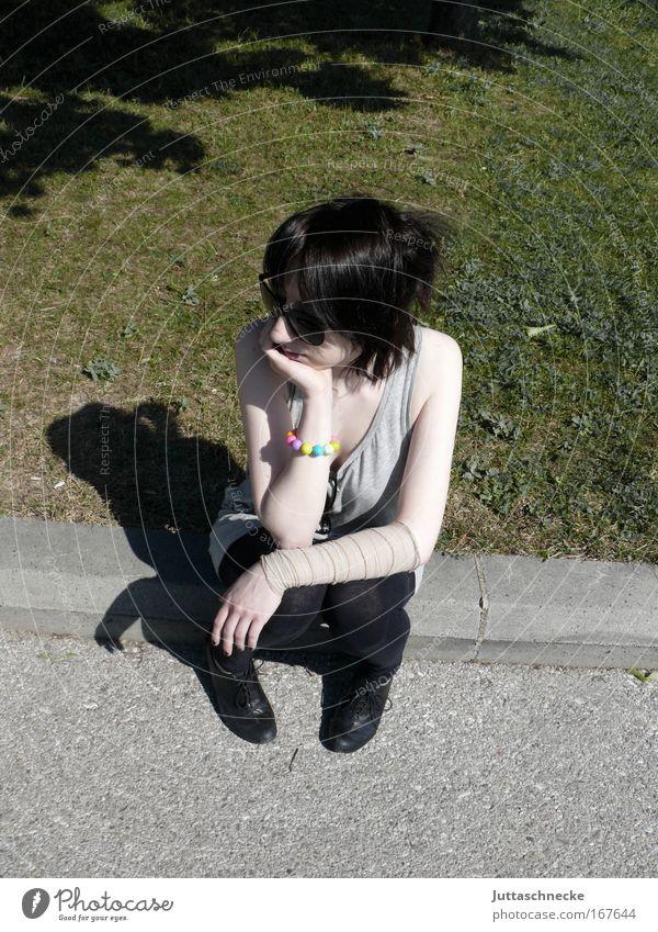 Long while Woman Young woman Sit Wait Boredom Break rest Observe Curbside Park Lawn Shadow Summer Bandage Sunglasses Rest on Juttas snail Day