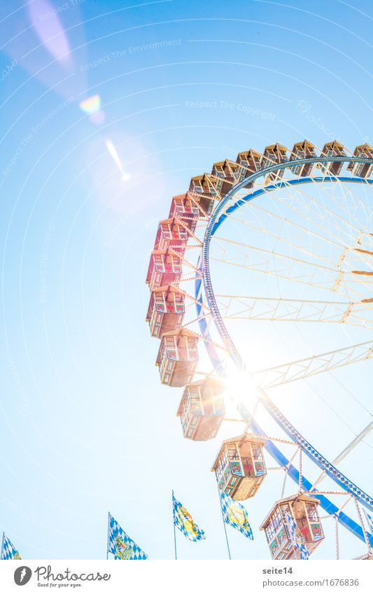 Oktoberfest. Ferris wheel, blue sky. Folk festival. Sunlight Background picture Blue Lens flare Bavaria Germany Freedom Leisure and hobbies Sky Happy