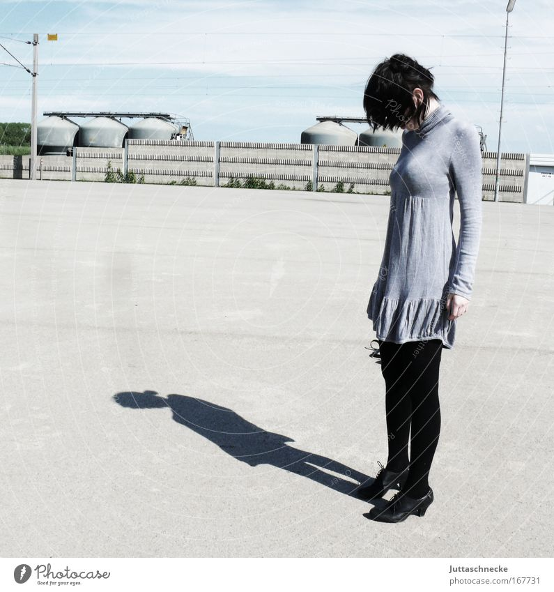 Let one's head hang Woman Young woman Shadow Contrast Sunlight Gray Dress Mini dress Sadness Frustration Loneliness Concrete Places Pallid Subdued colour Grief