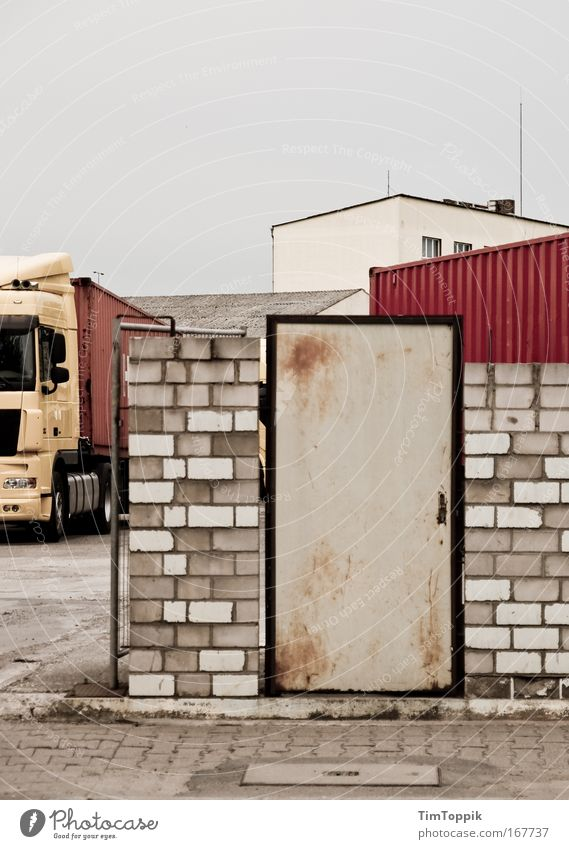 House (Residential Structure) Loneliness Wall (building) Gray Wall (barrier) Building Door Transport Facade Empty Gloomy Logistics Factory Truck