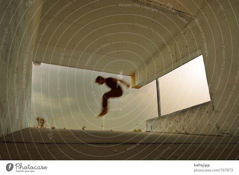 Human being Man Adults Wall (building) Playing Jump Wall (barrier) Legs Feet Weather Gold Flying Transport Bottom Fitness Storm