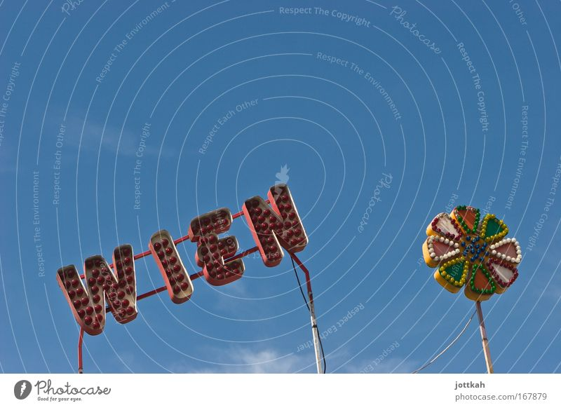 """Lettering """"Wien"""" and a flower consisting of coloured light bulbs Capital city Leisure and hobbies Tourism Vienna Prater Fairs & Carnivals Typography writing"""