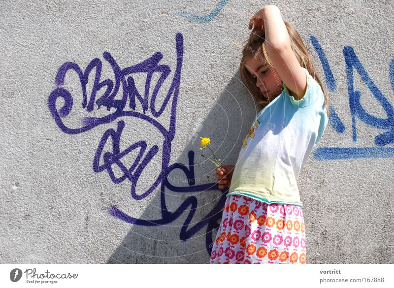 Human being Child Nature Blue Green Beautiful Girl Flower Yellow Feminine Wall (building) Graffiti Wall (barrier) Think Spring Line