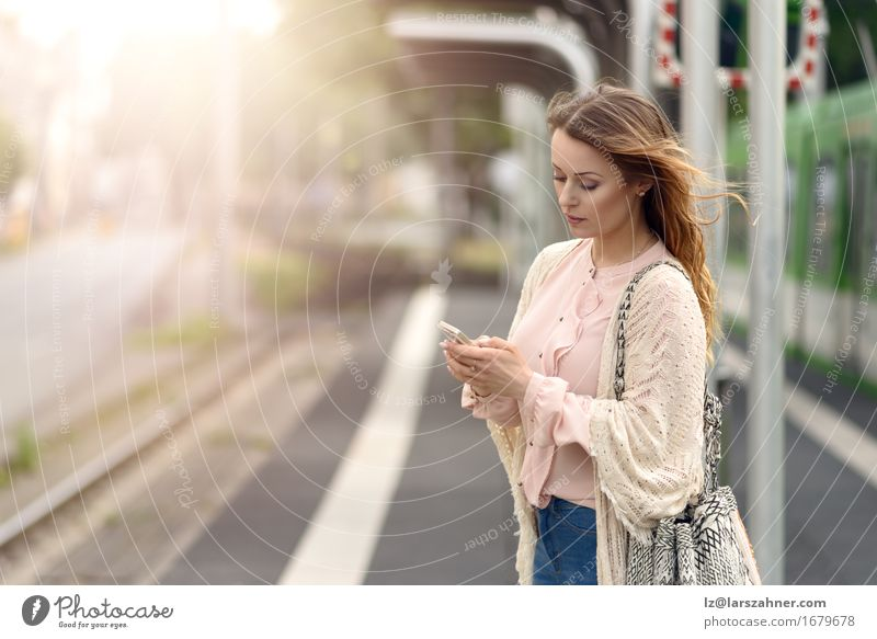 Attractive young woman with mobile phone Woman Youth (Young adults) Summer 18 - 30 years Face Adults Warmth Feminine Lifestyle Modern Technology Telephone Mobility Digital Station Earnest