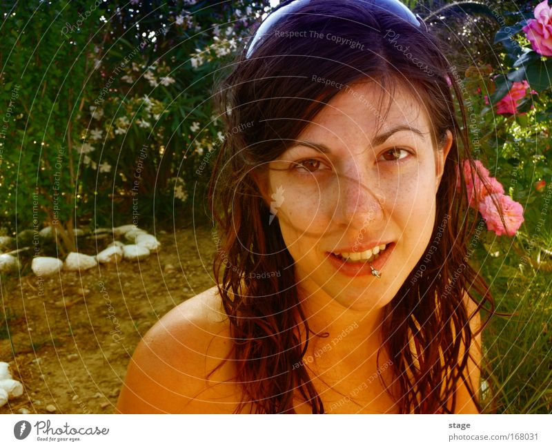 Female garden Colour photo Close-up Copy Space left Copy Space bottom Day Sunlight Portrait photograph Looking into the camera Happy Beautiful