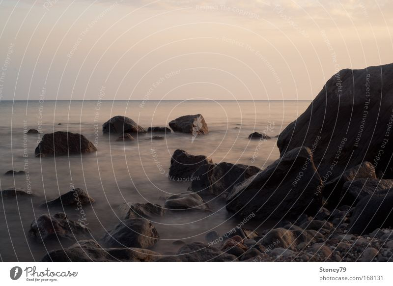 Rocks in the sea Colour photo Exterior shot Deserted Copy Space top Evening Contrast Sunlight Long exposure Deep depth of field Central perspective Ocean