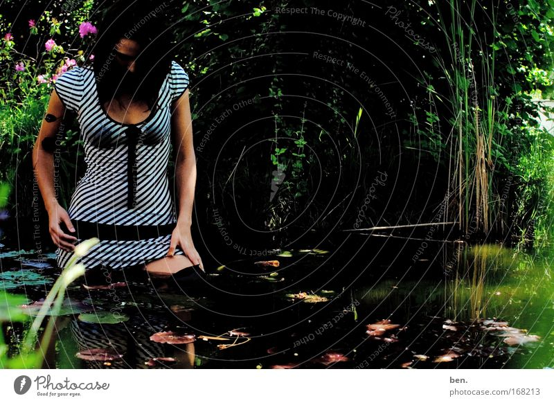 gardening Colour photo Exterior shot Copy Space right Day Shadow Reflection Full-length Downward Exotic Beautiful Human being Feminine Young woman