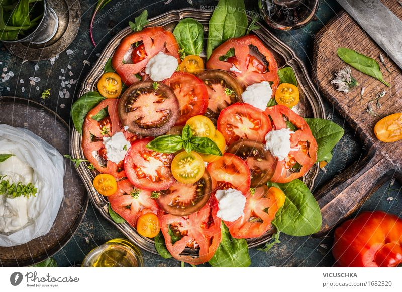 Classic caprese salad with tomatoes and mozzarella Food Cheese Vegetable Herbs and spices Cooking oil Nutrition Lunch Organic produce Diet Italian Food Crockery