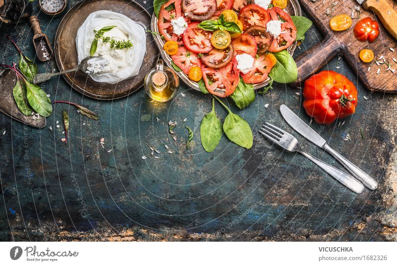 Tomato Mozzarella Salad with cutlery Food Cheese Vegetable Lettuce Herbs and spices Cooking oil Nutrition Lunch Buffet Brunch Banquet Organic produce