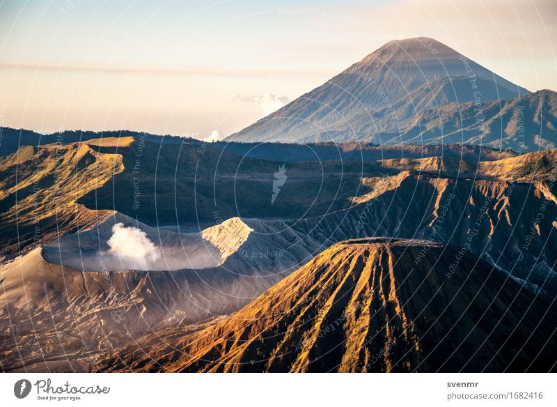 Bromo sunrise Vacation & Travel Adventure Far-off places Expedition Landscape Clouds Mountain Volcano bromo Volcanic crater Exhaust gas Shroud of fog Outbreak