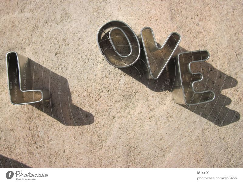 L OVEr Sign Characters Love Spring fever Infinity Metalware Tin Cookie baking tin Sand toys Subdued colour Close-up Deserted Baking cookie cutter Shadow