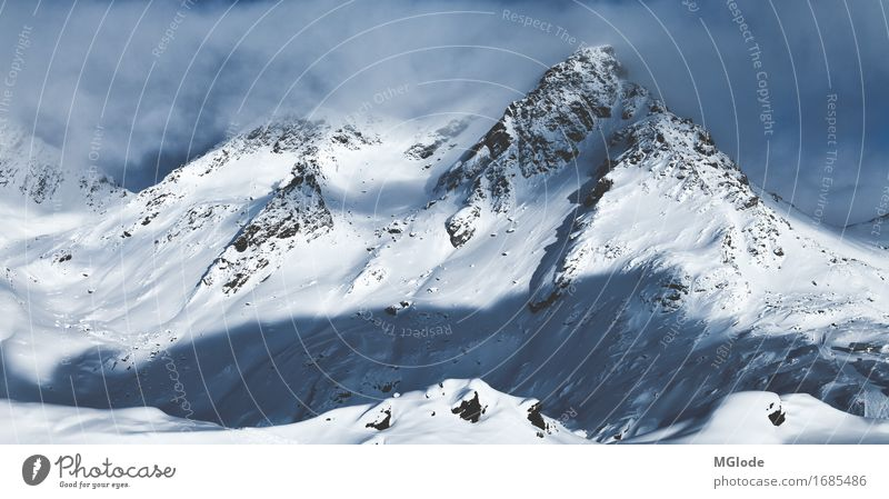 peaceful giant Adventure Freedom Winter Winter vacation Mountain Skis Snowboard Ski run Nature Landscape Elements Wind Ice Frost Alps Snowcapped peak Dream Blue