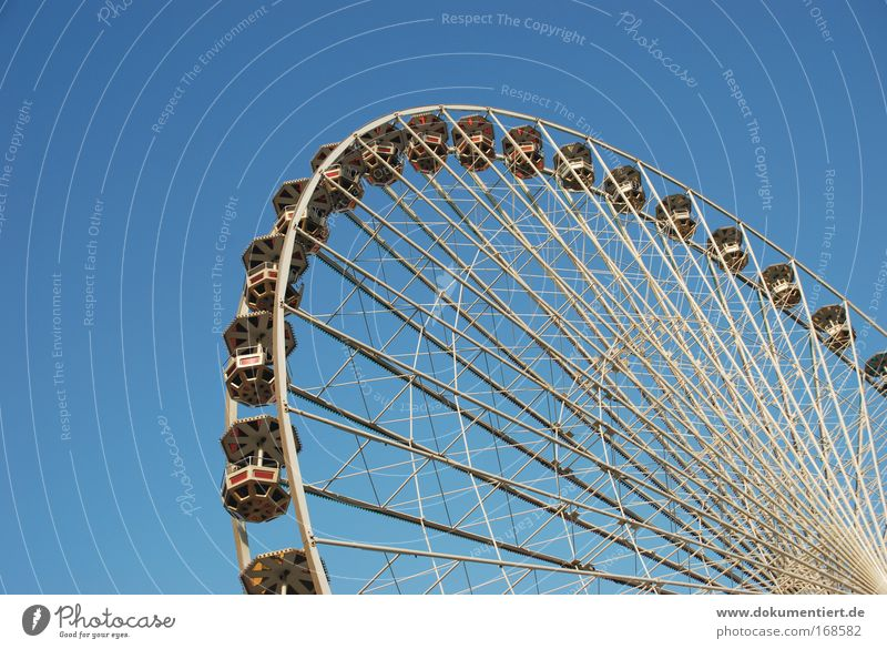 Ferris wheel Colour photo Exterior shot Copy Space left Copy Space bottom Day Joy Relaxation Leisure and hobbies Playing Fairs & Carnivals Trip Closing time