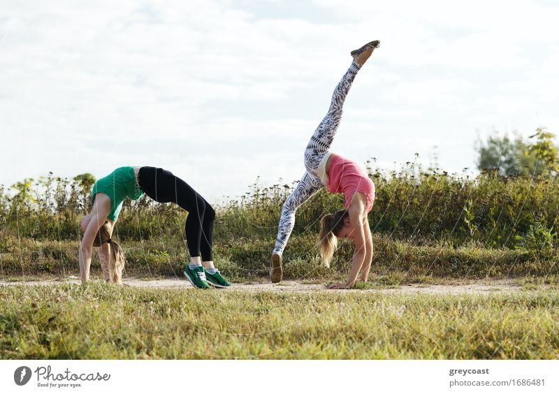 Two girls training Human being Woman Nature Youth (Young adults) Young woman Landscape Girl 18 - 30 years Adults Grass Together Friendship Action Fitness