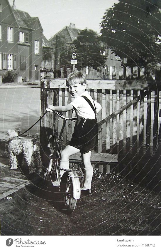 Human being Child Dog Animal Playing Boy (child) Infancy Masculine Stand Pet 3 - 8 years Scooter The fifties Black & white photo Post-war period Fox terrier