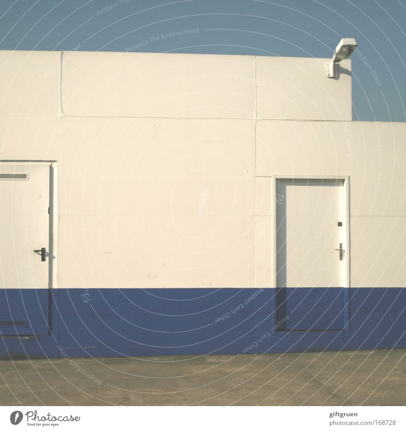 Sky White Blue Lamp Wall (building) Wall (barrier) Building Door Industry Industrial Photography Stripe Manmade structures Workshop Entrance Floodlight