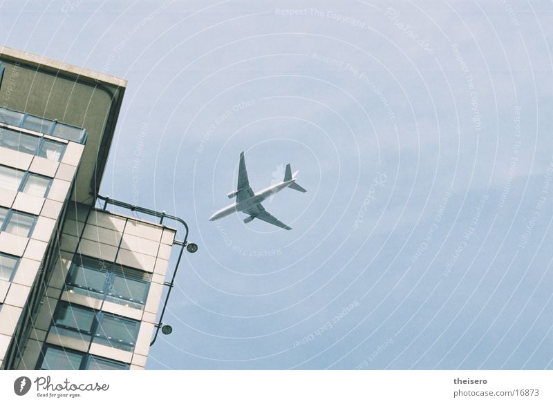 landing approach Airplane High-rise Aviation Airplane landing Perspective Passenger plane Near