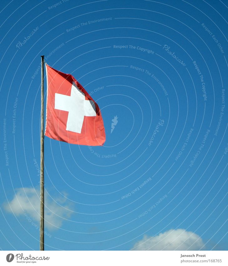 Switzerland in the sky Vacation & Travel Tourism Winter Sky Clouds Beautiful weather Flag Blue Red White Swiss flag Flagpole Sky blue Wind Colour photo