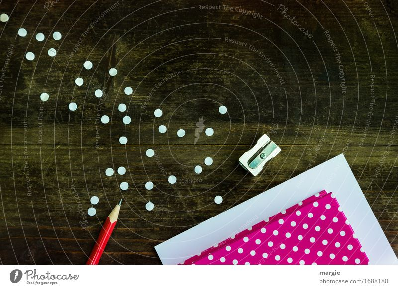 Collect points: red paper and white points with red pencil and sharpener on a wooden table Education School Study Profession Office work Workplace