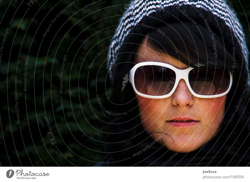 sunglasses and bobble hat Colour photo Exterior shot Copy Space left Day Portrait photograph Looking Looking into the camera Feminine Woman Adults Head