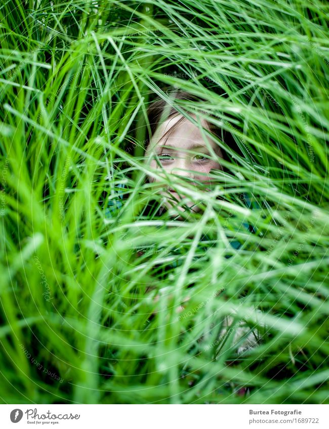 Girl in the Grass Garden Human being Feminine Child Head 1 Foliage plant Long-haired Smiling 2016 D700 Lina nikonic Burtea Photography 50mm Blur Colour photo