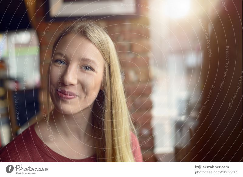 Smiling pretty young woman with an amused look Human being Woman Youth (Young adults) 18 - 30 years Face Adults Feminine Happy Friendship Blonde Smiling Friendliness Restaurant Café Expression Amused