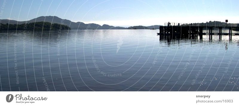 the lake Lake Deep Dark Undulating Body of water Europe Great Britain Scotland Loch Lomond Glasgow Footbridge Wood Panorama (View) Calm Serene Contentment Blue