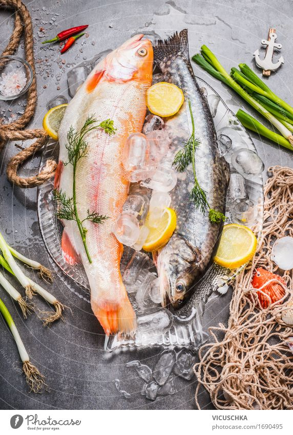 Raw whole trout with fresh ingredients Food Fish Vegetable Nutrition Lunch Dinner Banquet Business lunch Organic produce Vegetarian diet Diet Bowl Style