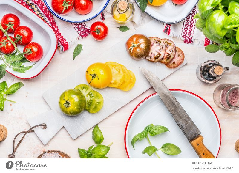Slices of colorful tomatoes with knife Food Vegetable Lettuce Salad Herbs and spices Cooking oil Nutrition Lunch Dinner Buffet Brunch Banquet Organic produce