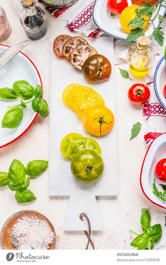 Green, yellow and red tomatoes on marble chopping board Food Vegetable Lettuce Salad Herbs and spices Cooking oil Nutrition Lunch Dinner Buffet Brunch