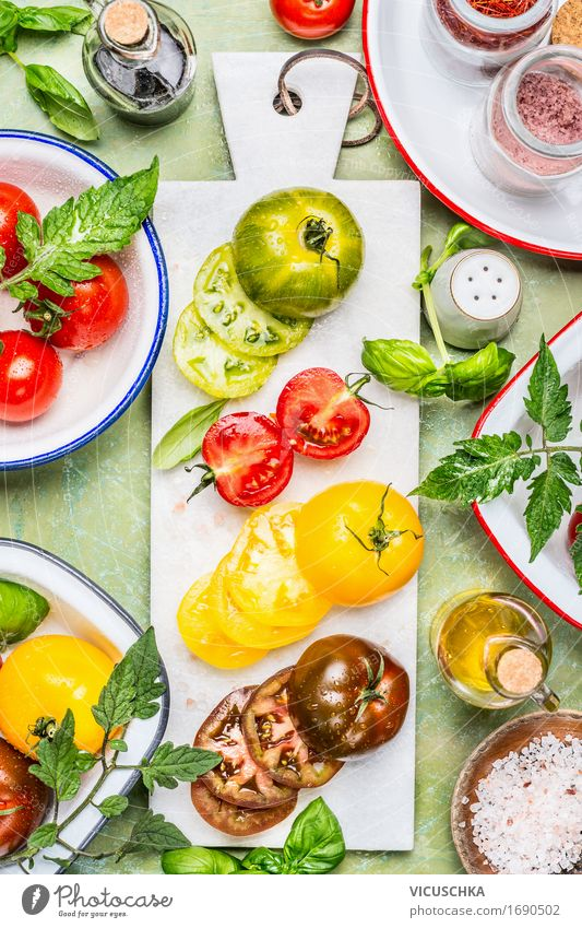 Colourful tomatoes cut into slices with cooking ingredients Food Vegetable Lettuce Salad Herbs and spices Cooking oil Nutrition Lunch Dinner Buffet Brunch