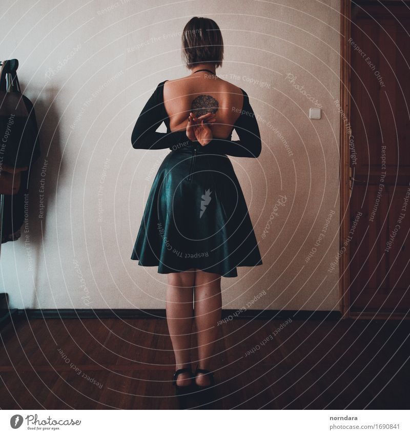 Girl with a tattoo on her back Young woman Youth (Young adults) Woman Adults Body Skin Back Legs 1 Human being Wall (barrier) Wall (building) Clothing Skirt