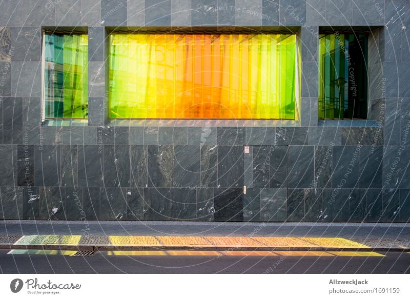 variegated Capital city Architecture Facade Prismatic colors Rainbow Yellow Green Red coloured glass Pane Window Blaze of colour Play of colours