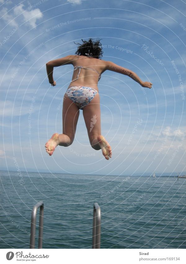 Human being Child Youth (Young adults) Water Sky White Blue Summer Joy Clouds Life Feminine Jump Hair and hairstyles Feet Lake
