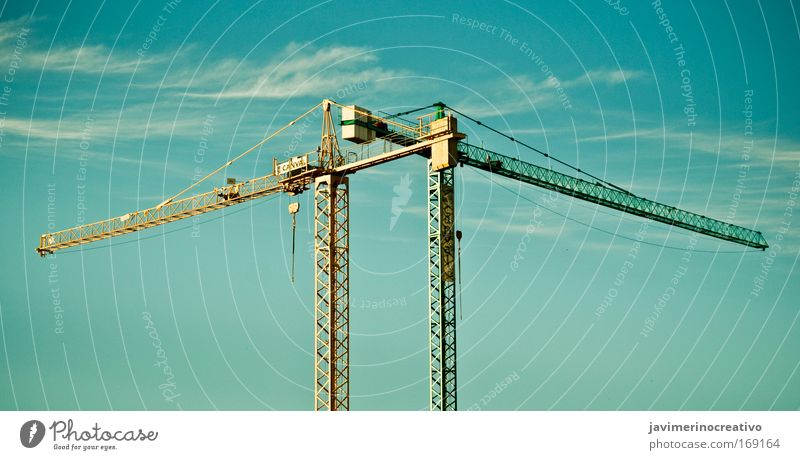 twocrane Sky Green Blue Clouds Yellow Far-off places Design Industry Modern Logistics Construction site Firm Craft (trade) Machinery Economy Trade