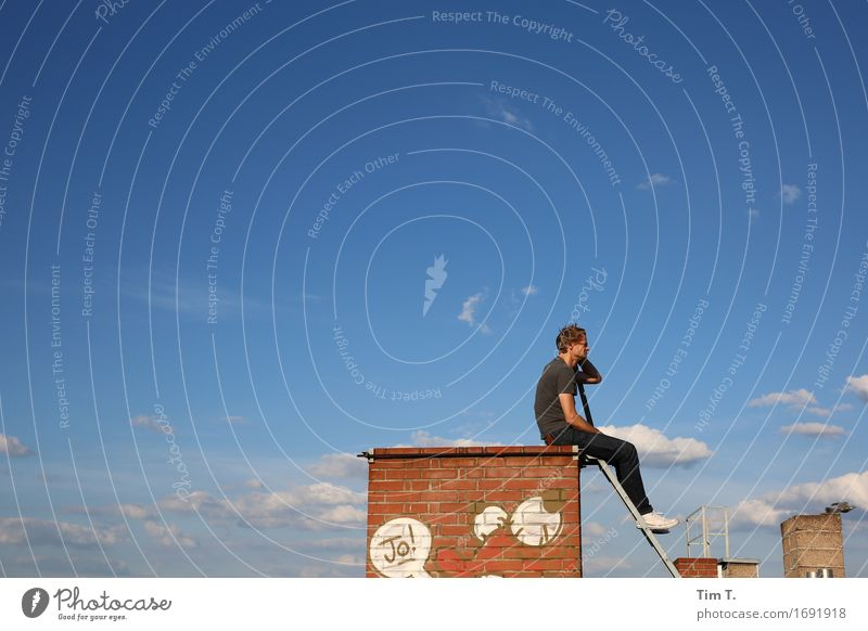rest Human being Man Adults 1 30 - 45 years Berlin Prenzlauer Berg Town Capital city Downtown Old town Roof Chimney Stagnating Dream Sky Graffiti Clouds Blue