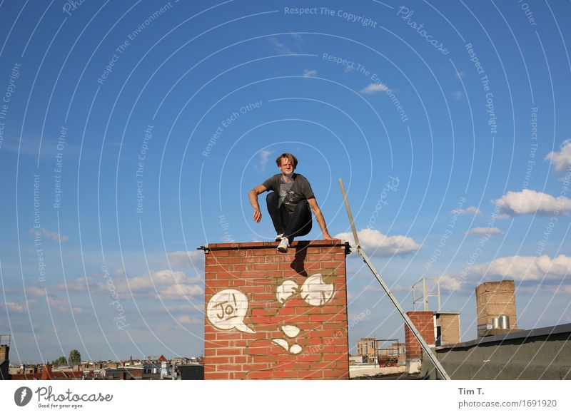 doughnut Human being Masculine Man Adults 1 30 - 45 years Berlin Prenzlauer Berg Town Capital city Downtown Old town Roof Chimney Loneliness Sky Clouds Graffiti
