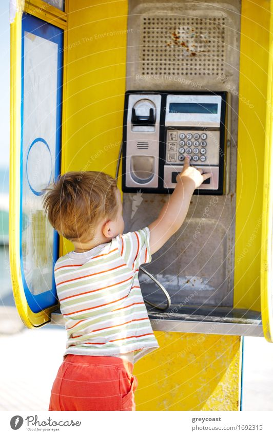 Young boy talking to the phone in a booth Human being Child Street To talk Boy (child) Small Blonde Infancy Europe Retro Baby Telephone Cellphone Listening