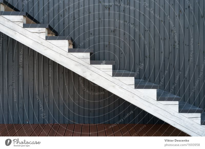 White wooden staircase on the background of colored lines Old Beautiful White House (Residential Structure) Architecture Style Building Wood Brown Design Decoration Modern To fall Climbing Furniture Story