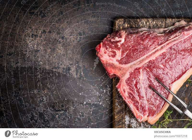 T-Bone Steak with meat fork on old cutting board Food Meat Herbs and spices Nutrition Dinner Banquet Business lunch Organic produce Fork Style Design Table