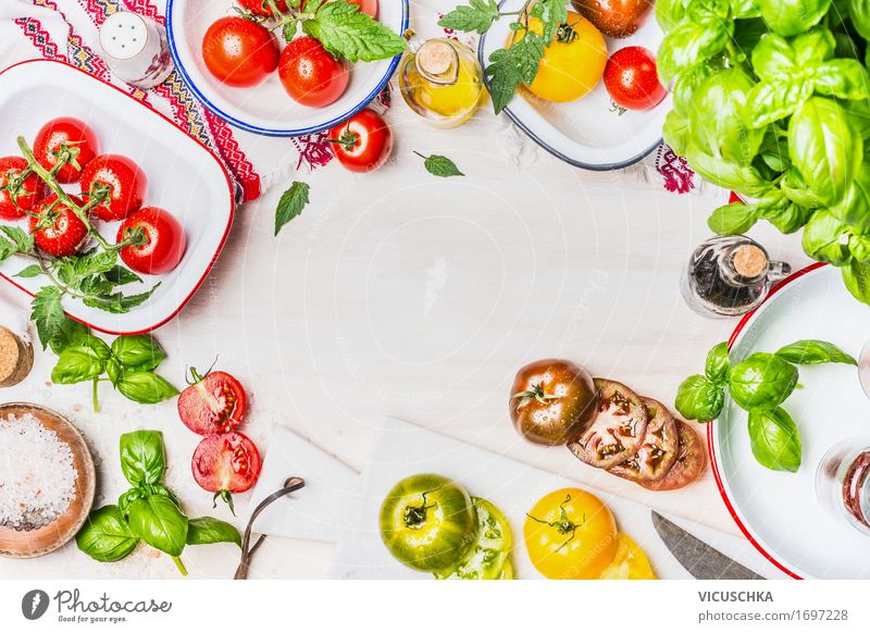 Variety of colorful tomatoes with salad ingredients Food Vegetable Lettuce Salad Herbs and spices Cooking oil Nutrition Lunch Dinner Organic produce