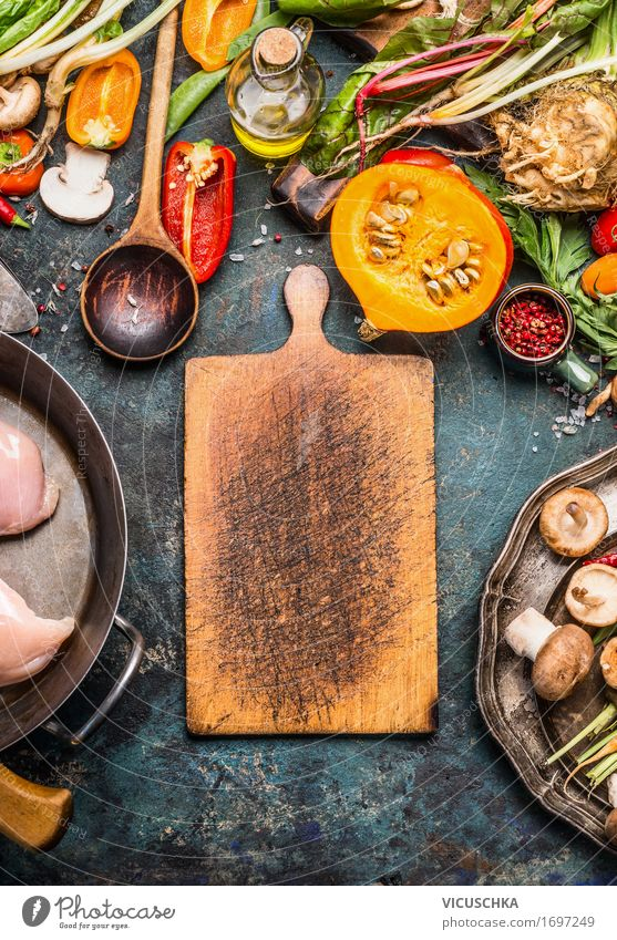 Cutting board with pumpkin and ingredients Food Vegetable Herbs and spices Cooking oil Nutrition Dinner Banquet Organic produce Crockery Pot Spoon Style Design
